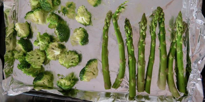 meal prep roasted vegetables broccoli and asparagus on a tray