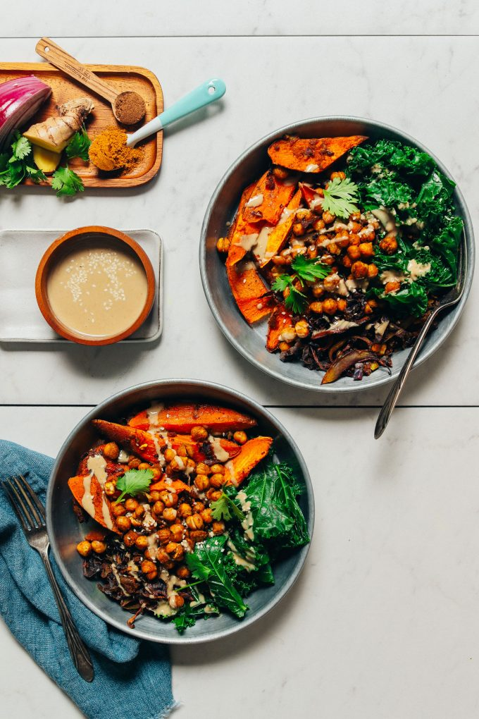 Curried Sweet Potato and Chickpeas in bowl with fork and teal napkin