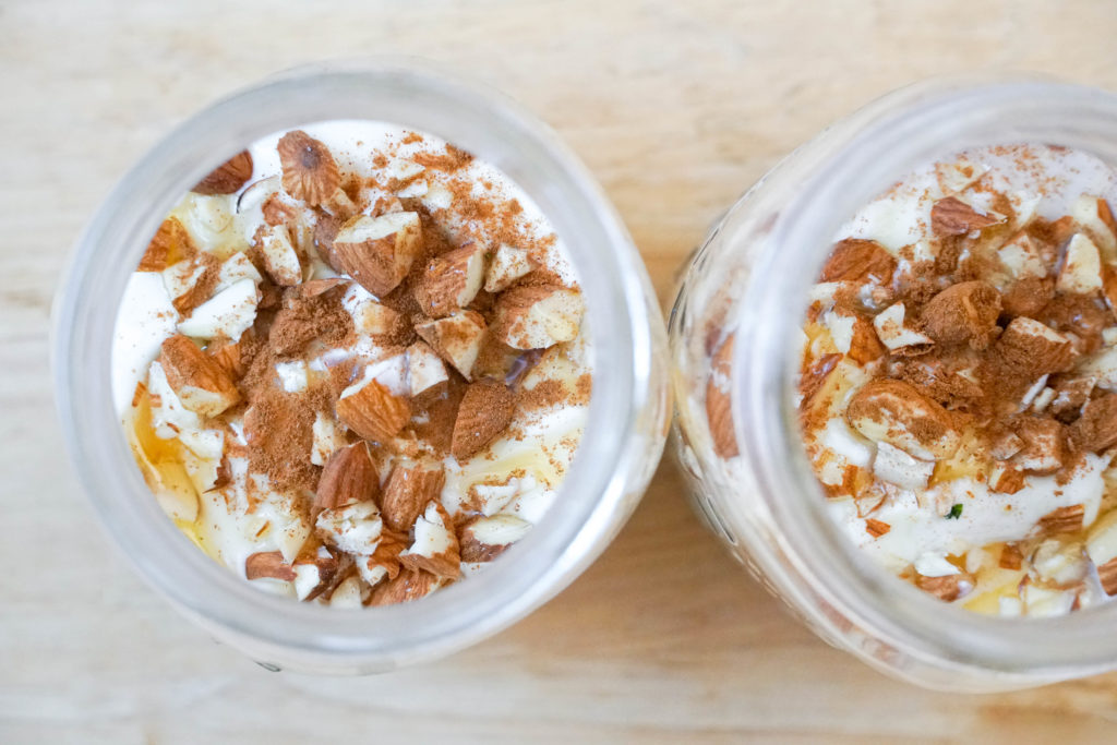 Two mason jars filled with horchata overnight oats with chopped almonds on top