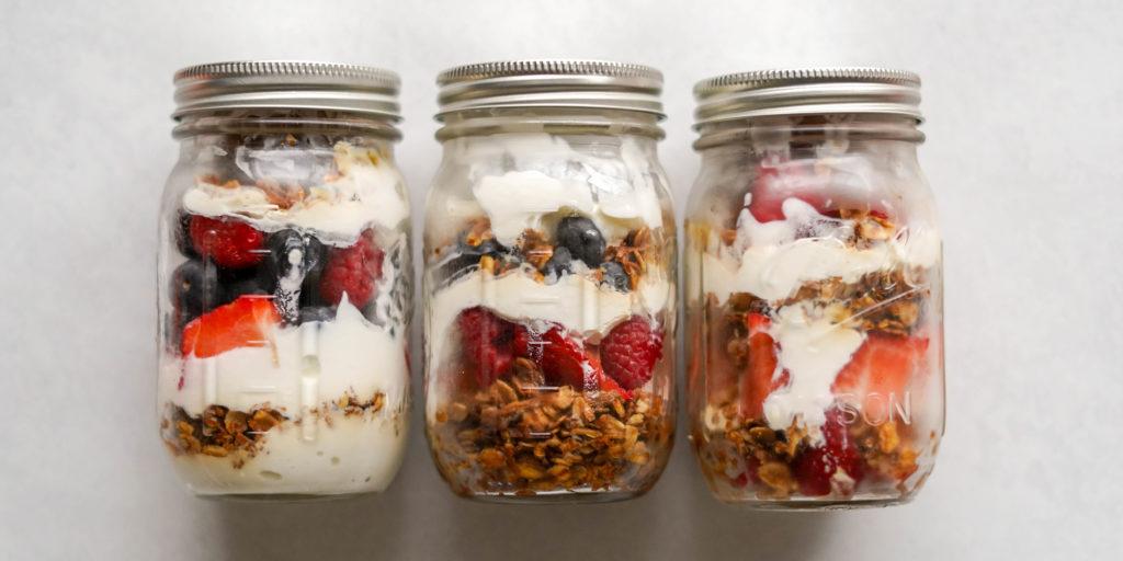 mason jars with homemade granola for parfait recipe