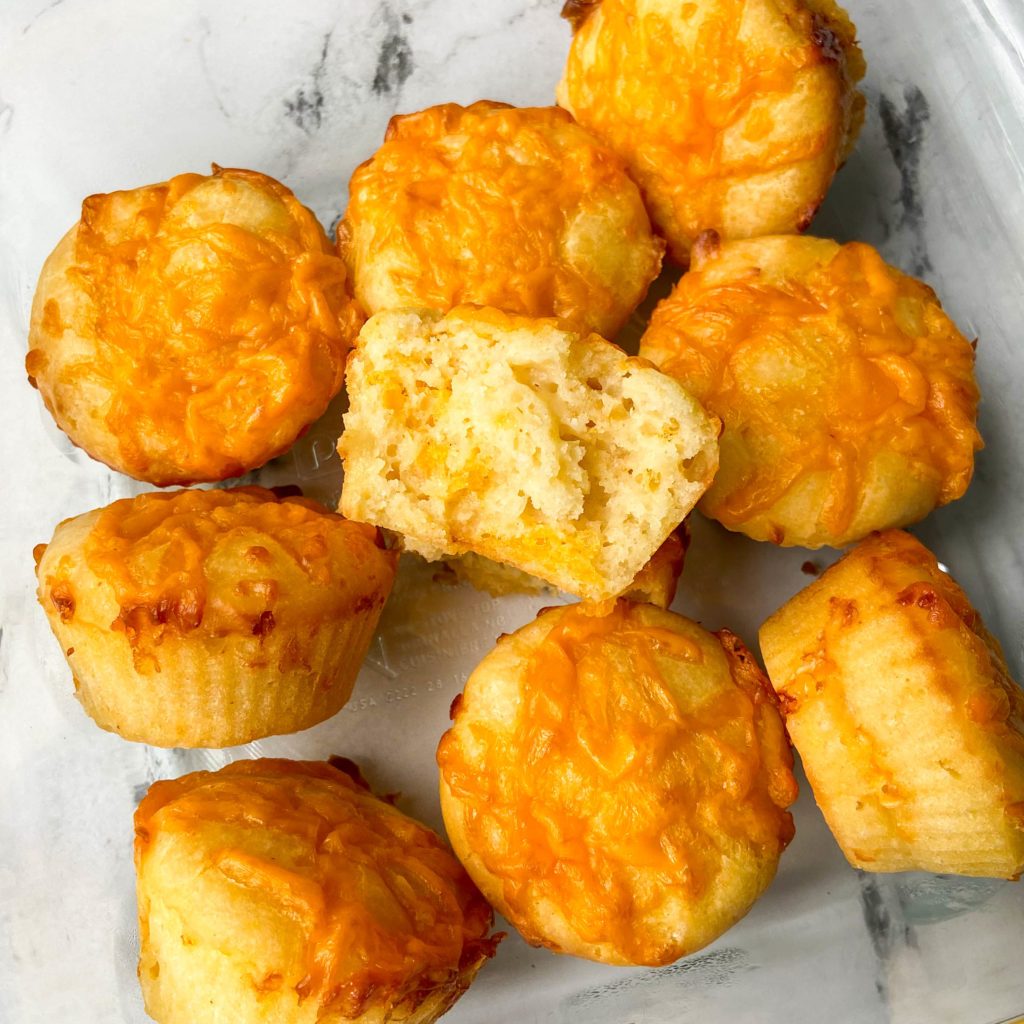 Golden brown savory muffins baked with cheddar cheese