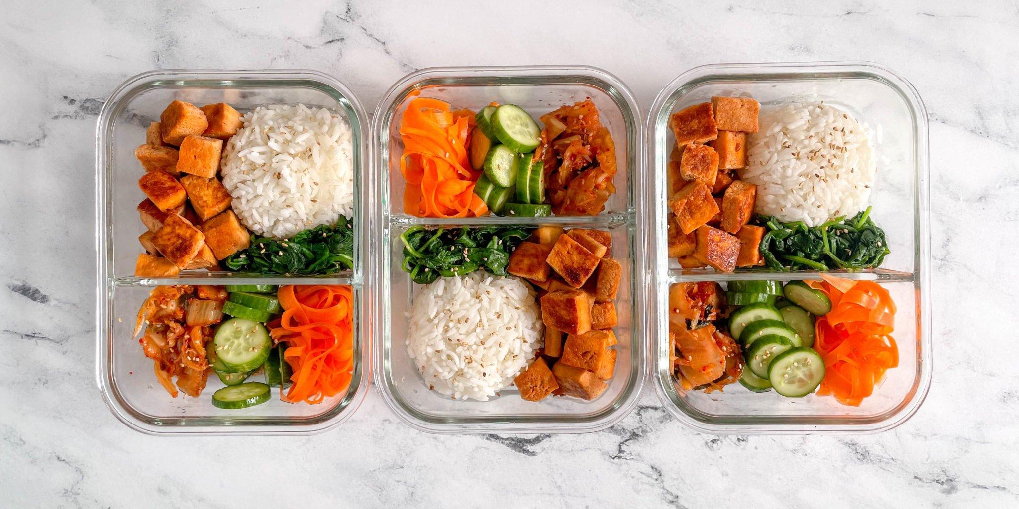 Vegetarian Bibimbap bowls in three meal prep containers