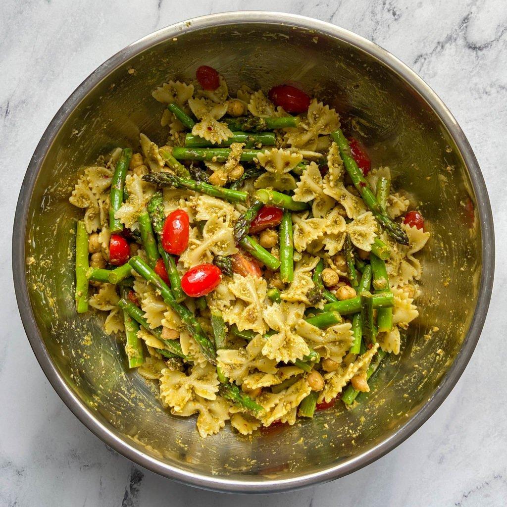 veggie pesto pasta with chickpeas in a bowl